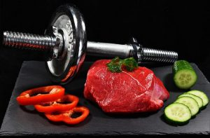 meat with vegetables and bar bell